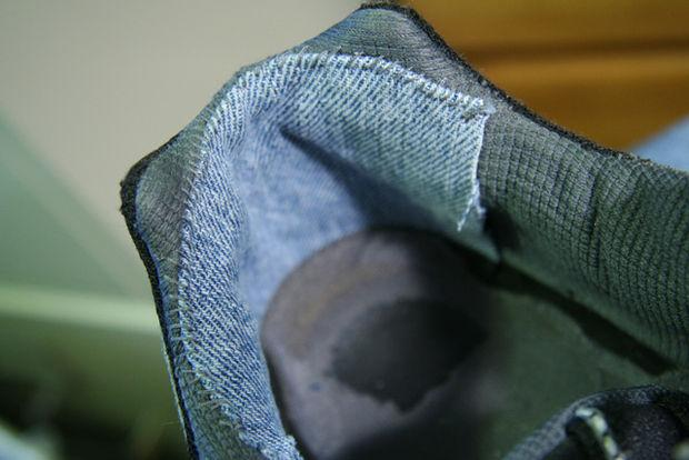 Stitch cloth to repair the heel of the shoe.
