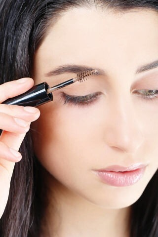 STEP 7  To set the look and hold the hairs in place, comb through brows with a colored gel.