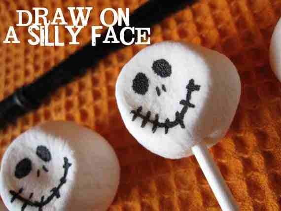 Next using your food writer or black frosting make a skeleton face…