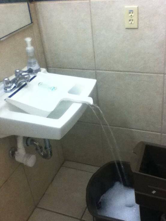 Use a dustpan to fill up a bucket that can't fit in the sink.