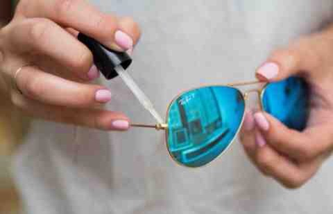 4. Tighten your sunglasses with a dab of clear nail polish.  If the arm of your sunglasses is a bit loose and you don't have a tiny screwdriver handy, paint a small bit of polish over the hinge to temporarily tighten it.