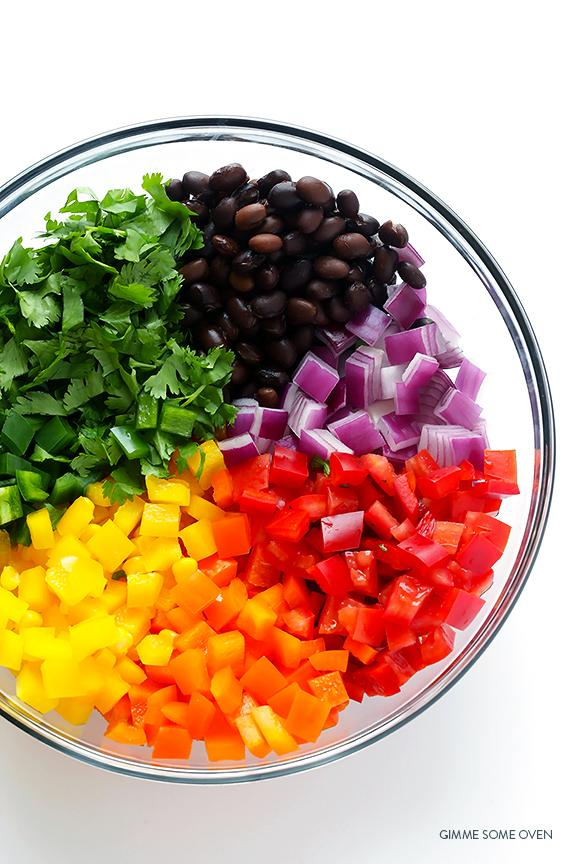 """Red: roma tomatoes and red bell peppers Orange: orange bell peppers Yellow: corn and yellow bell peppers Green: jalapeno and fresh cilantro """"Blue"""": black beans (eh, close enough) Purple: red onion"""