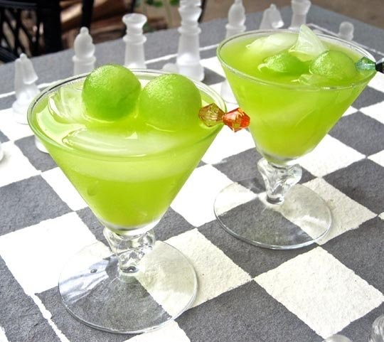 The Melon Ball (makes 1 drink)  2 ounces Midori 1 ounce vodka Top up glass with fresh-squeezed orange juice (or bottled if you prefer) (martini glasses work best) top off with fresh scooped melon balls  In a glass filled with ice, add the Midori and vodka. Top off with orange juice.