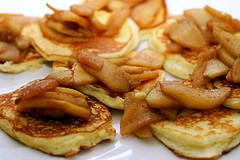 Serve the pancakes with the sauteed apples and the maple syrup.