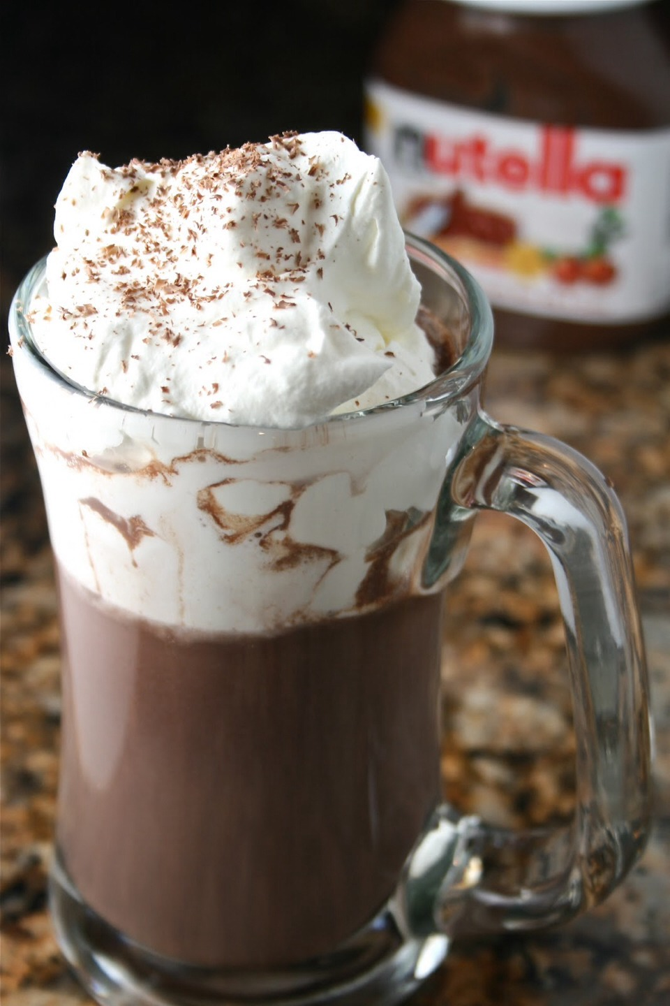 Mix Nutella with milk. Put in the microwave for four minutes. After two minutes has passed by take it out, stir it then put it back in for the other two minutes. (Make you add in 1 spoonful (round about) because when I did it, it was sweet!:)
