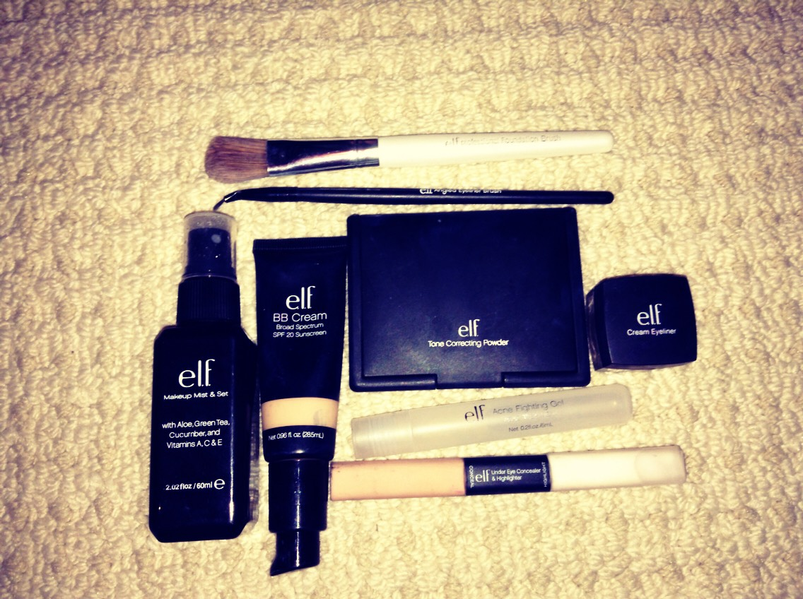 all of these products are Elf and from Walmart . bottle on (left) first is the makeup mist and set, beside it is the BB cream, the big looking black square is tone correcting  powder,below that is acne fighting gel, below that is under eye concealer and highlighter next foundation brush