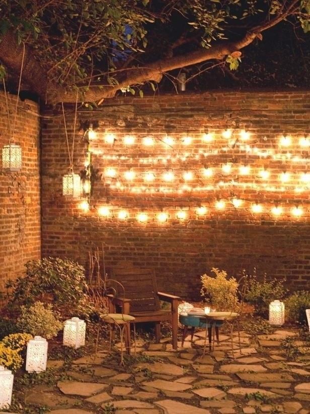 17. If you want to create quick outdoor mood lighting, hang string lights along a wall.