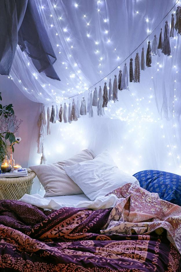 1. To seriously upgrade your sleeping situation, drape lights on top of your canopy.