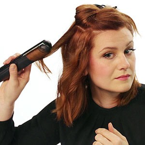 3. Go Curly Flip hair over the iron, run all the way through hair, then twirl to hold in place.