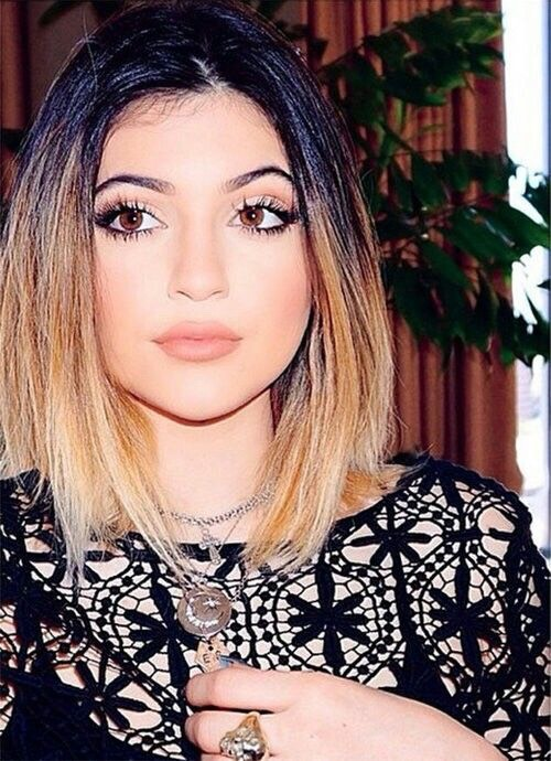 Now this look is Ombré and she made it a sleek mid-part look that I LOVE!