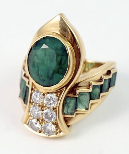 The Art Deco Era was wild about Egyptian revival--wouldn't anyone be with this ring? Circa 1935, it is fine craftsmanship fromRene Boivin. The ring features emeralds and diamonds, done in 18k yellow gold.