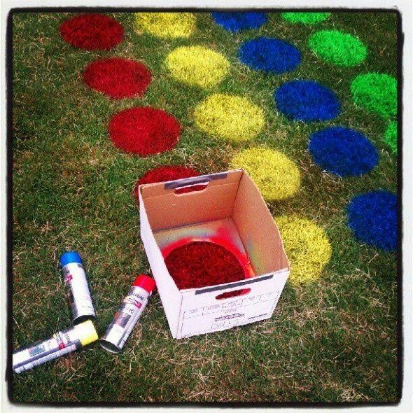 Fun activity to do in your backyard. Just cut a hole in a box and spray different paint colors and then you have twister on your grass to play together as a family