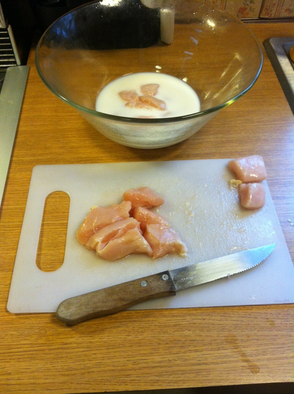 Start by cutting 4 boneless skinless chicken breasts into bite size pieces. Then whisk together 1egg and 1 cup milk in bowl and coat chicken pieces in mixture.