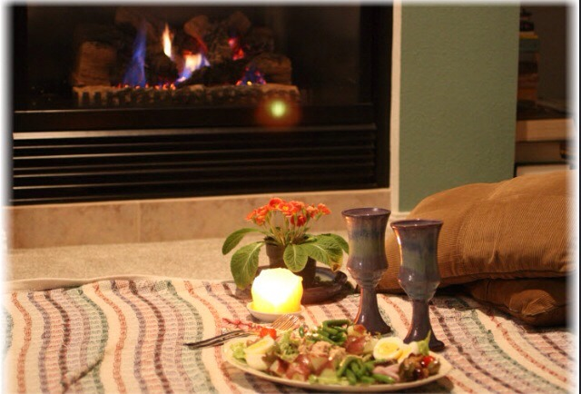 Have an indoor picnic on Valentine's Day. It's cheap and easy to do.