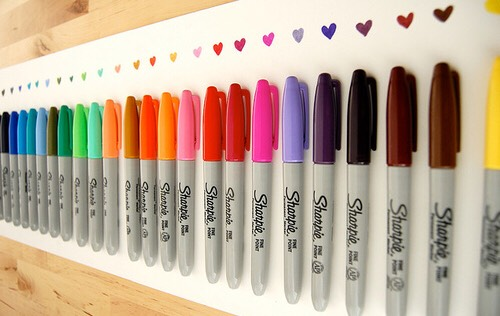 """Grab a sharpie of your choice and draw the """"tattoo"""" you want on you."""