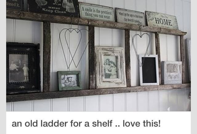 Hang an old distressed looking ladder to the wall for a rustic shelf, add rustic looking frames and rustic decor for a beautiful look..love this! Perfect idea for my sunroom!