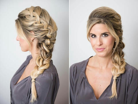 Start by curling your hair and teasing it at the hairline and crown to create major volume. Then, pull your hair over to the desired side and begin French braiding it, taking sections of varied thicknesses to make it appear thicker. Continue this technique to the ends,