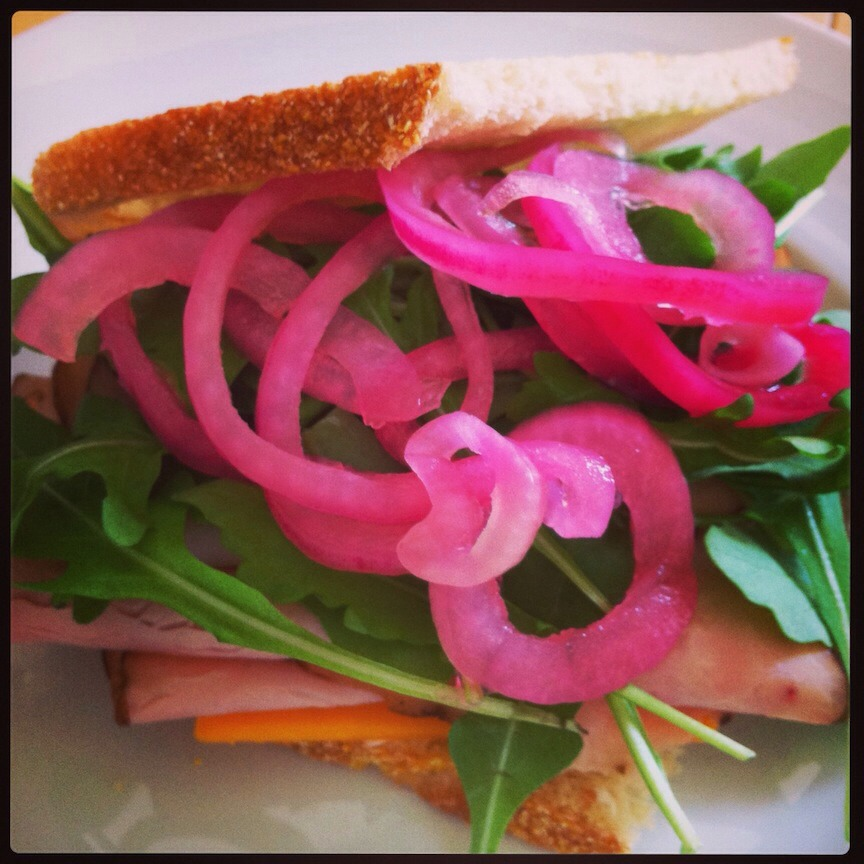 "Slice some red onion very thinly and throw it in the pickle juice for perfect pickled onions! The ""pickled"" onions liven up turkey, chicken or ham sandwiches, as well as hamburgers.  -Add cilantro and use the pickled carrots & onions as a topper for fajitas or tacos."
