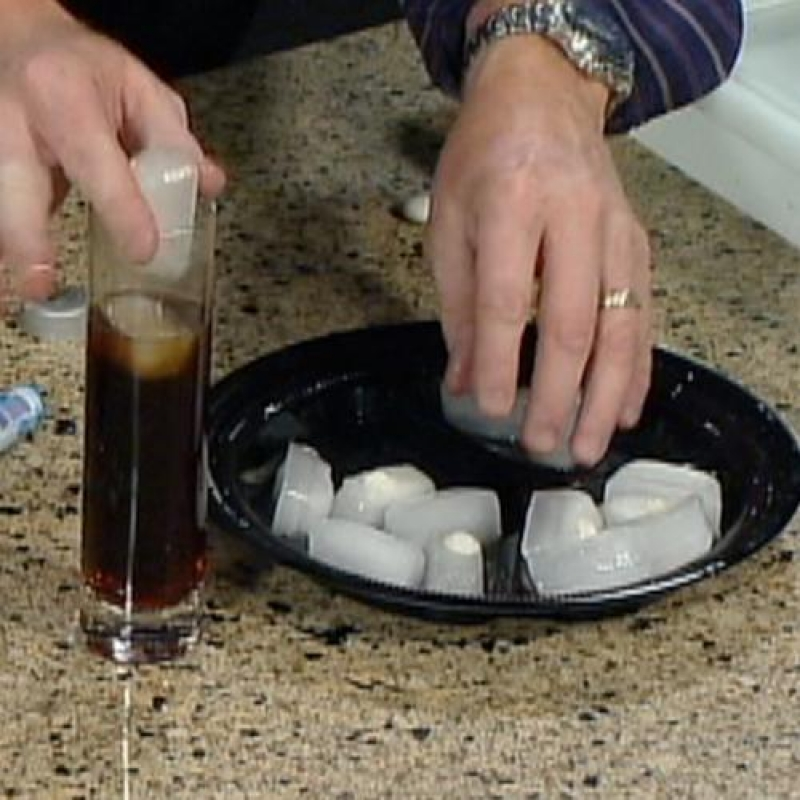 when the ice cubes are ready, pour out a glass of coke for your victem and add 1-2 ice cubes. As the ice melts the closer it gets to the mento, then BOOM it explodes!