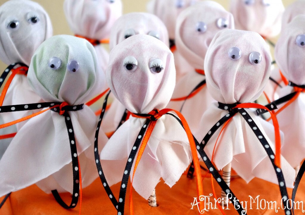supplies: suckers, googly eyes, Kleenex/cloth, ribbon  how to: grip the napkins/cloth over the sucker, after you have a ghost like figure tie off with fall themed ribbon, finish it off by adding googly eyes!