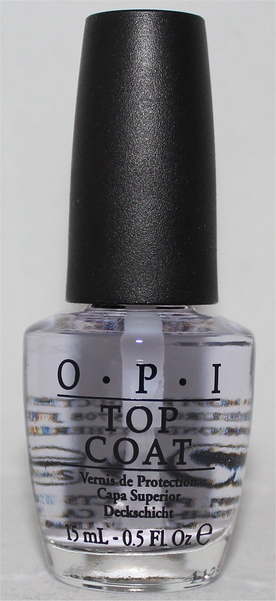 4) Now apply a top coat to seal in the glitter  and make the nail color look shiny. Now let the top coat completely dry (it helps if you put your nail in ice cold water) and the nail design is complete.