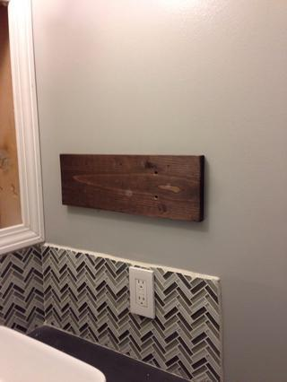 Then we found the stud and use the wood screws to secure the board to the wall.