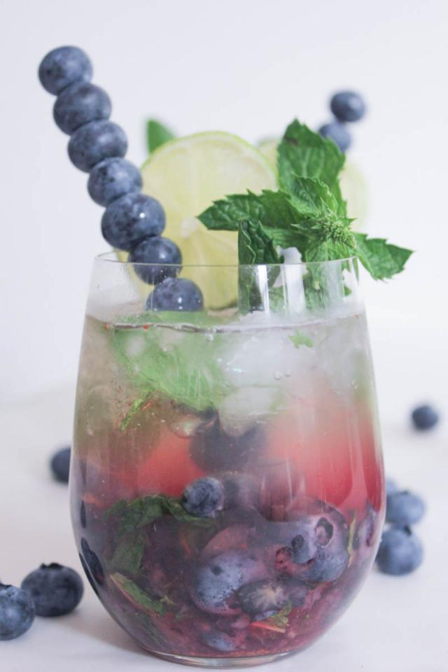 If you're in the market for a signature cocktail to serve at your upcoming summer soirées, this is it, folks. It's very pretty, and you can easily make the blueberry mojito base in bulk and then top individual glasses with champagne when it's time to partay.
