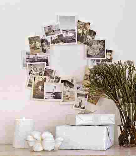 This indoor wreath is so easy and costs about $6. Go get some bordered black and white pics printed at walmart and tape them to a wall or secure to a flat piece of circular wire