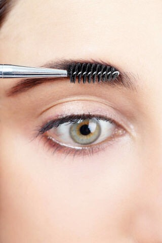 STEP 6  Brush through brows again with a spoolie to blend out the color and soften any harsh lines.