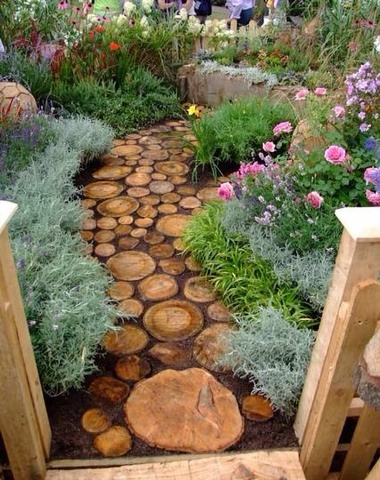 Make a log pathway from old trees chopped up and it looks beautiful