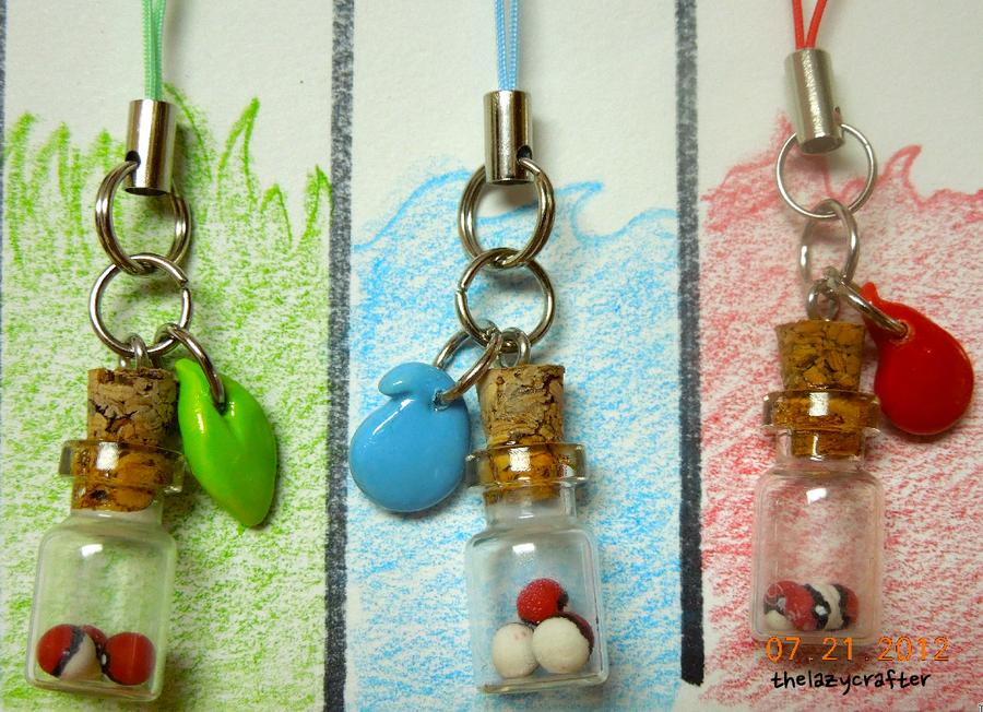 Now onto the Pokemon ideas. The bottle charm you see here are just basic Pokeballs made out of polymer clay.