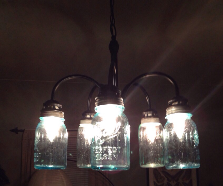 Drill holes through lids in the fixture size of an existing light fixture in your house.  www.etsy.com/shop/JunkyardJems