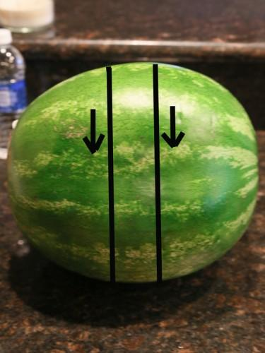 There are a couple of tricks if you have a really big watermelon. If you're watermelon is huge, then your sticks are going to be super long. You can remedy that by cutting a section out as shown above and then cutting with the method I discussed.