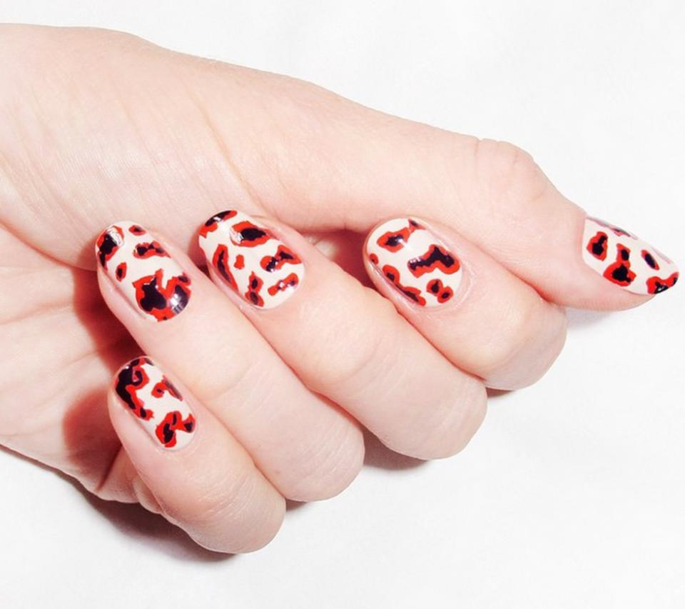"""Try The Body Shop Colour Crush Nail Polish in """"Pink Cream,"""" $8;  Gucci Nail Bold High-Gloss Lacquer in""""Iconic Red,"""" $29; Red Carpet Nail Lacquer in """"White Hot,"""" $8;  and Morgan Taylor Professional Nail Lacquer in """"Little Black Dress,"""" $9 to get this nail art look."""