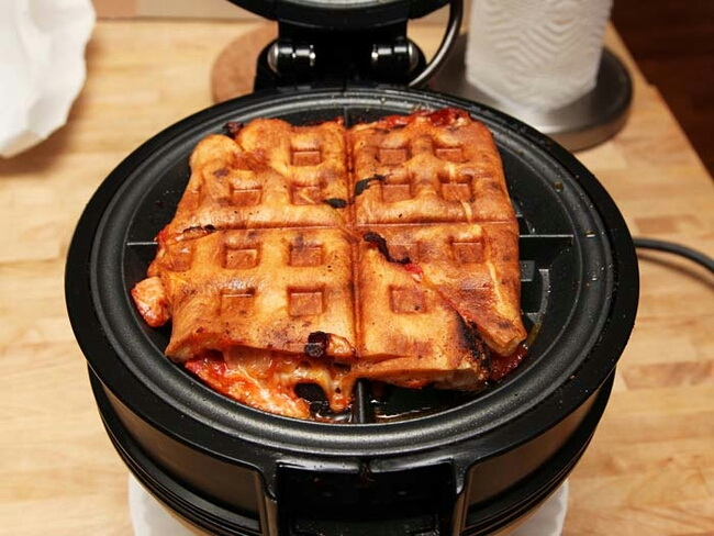 Reheat your pizza in a waffle iron.
