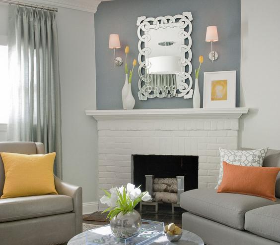 Silver Accents Cool metal touches give this room a sophisticated air. The scrolling mirror, the legs of the coffee table, even the fireplace andirons are all glossed in chic silver.