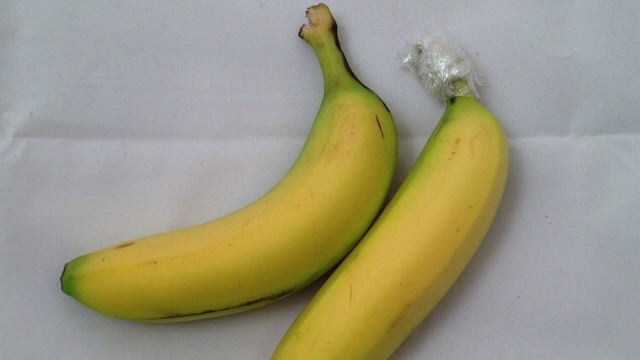 By separating them and wrapping the stem in plastic wrap. Your bananas will last twice as long!