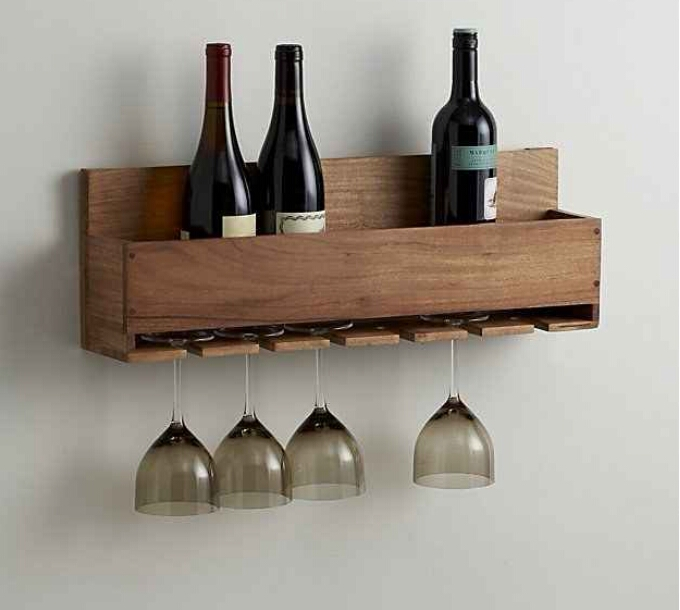 This rack that will hold wine glasses *and* bottles. ($49.95)  http://m.crateandbarrel.com/wine-stem-rack/s681734