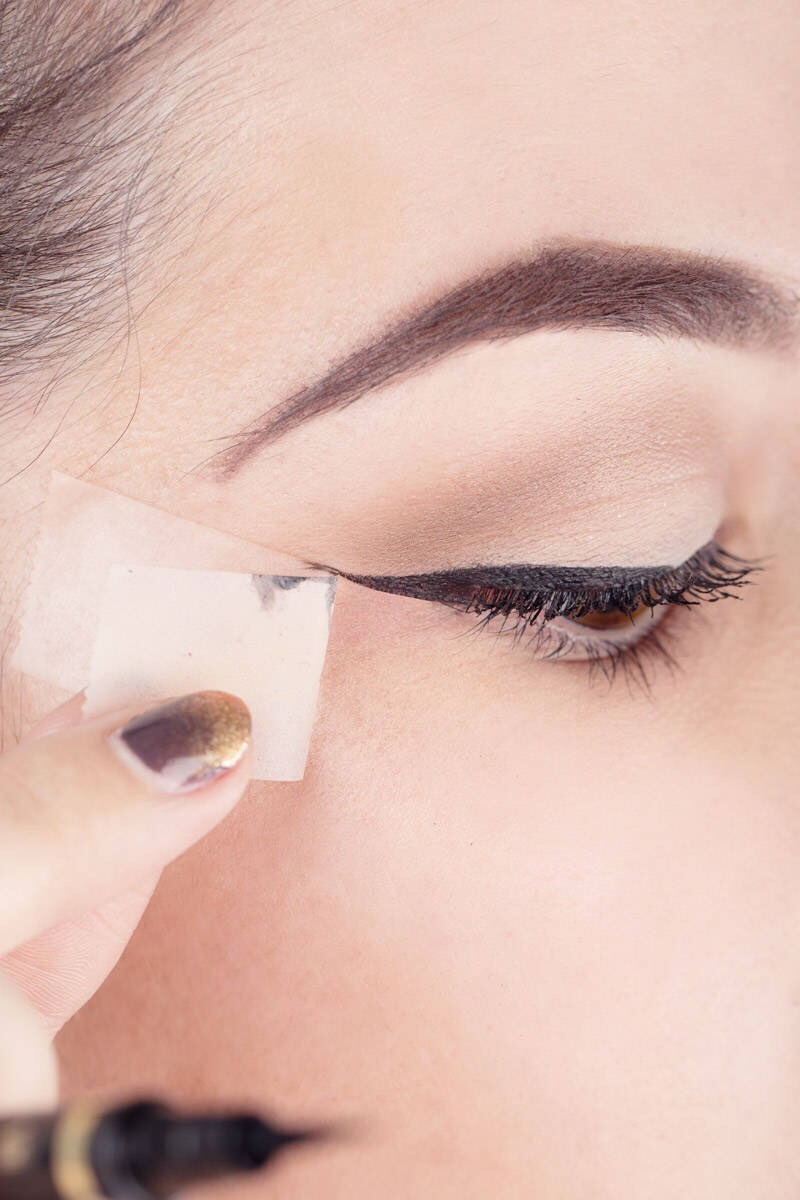 10. Use tape to get the perfect winged eyeliner look