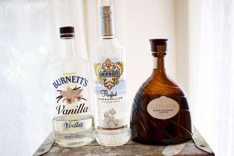 To make this martini, mix two parts Godiva White Chocolate Liqueur, one part vanilla vodka and one part fluffed marshmallow vodka (cake or whipped cream would work too). Shake them together in a martini shaker with ice and serve!
