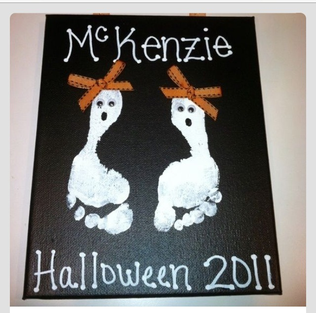 White acrylic paint and a little orange ribbon...this is a great idea to do each year my little ones love to see how much their feet have grown from the year before ;)