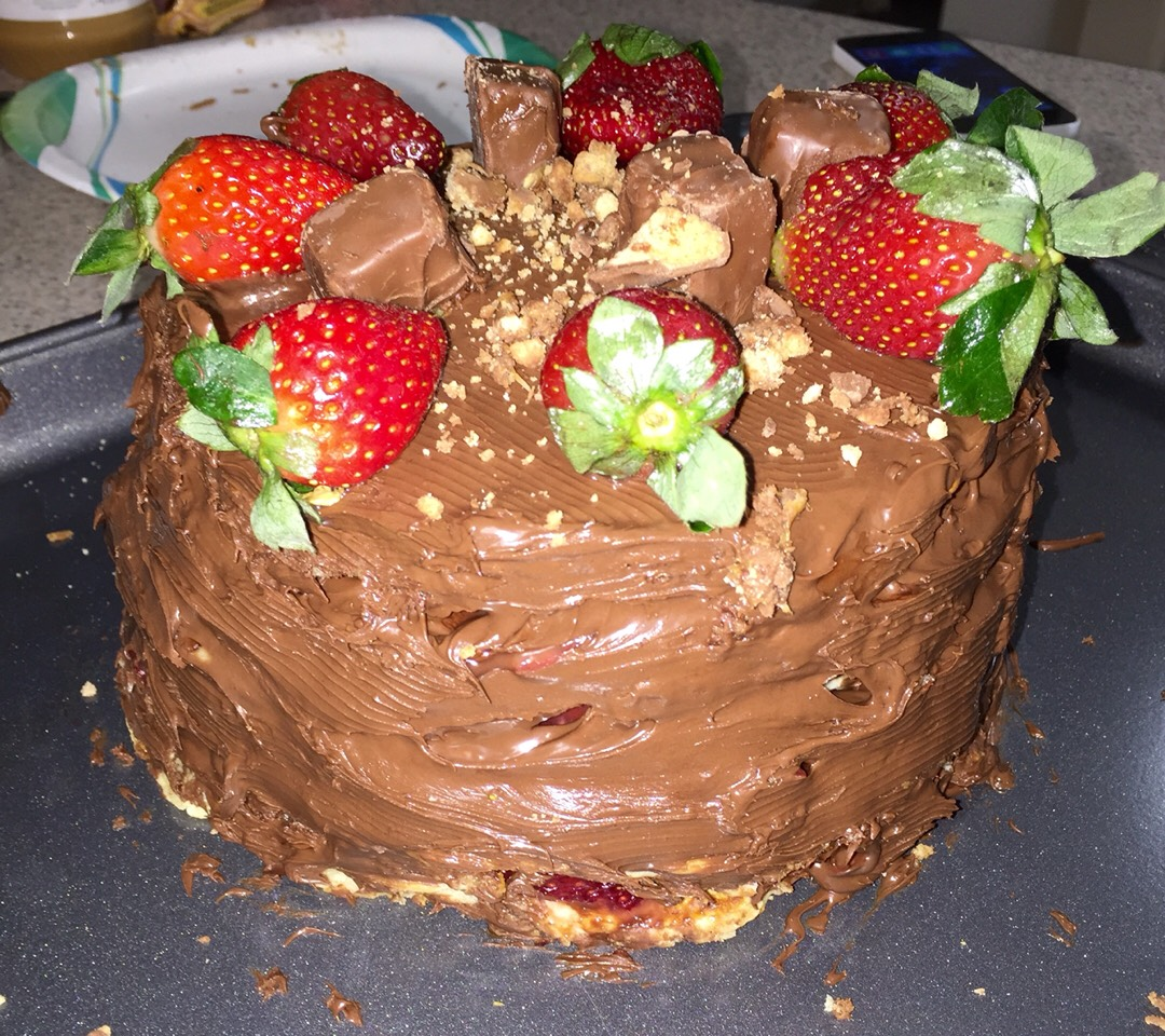 5.Add Nutella and strawberries in between each layer 6. Top it off with full fresh strawberries and chocolate crumbles