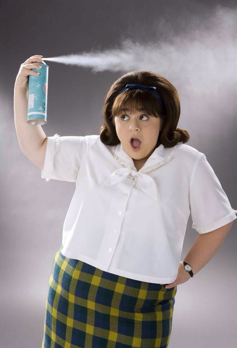 Hairspray and rubbing alcohol Wet the stain with cold water. Then spray hairspray on the stain. Add a few splashes of rubbing alcohol. Using a scrub brush, scrub the stain for at least one minute. Whilst scrubbing, pour cold water on the stain