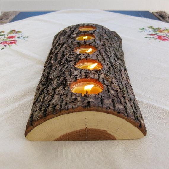 Half a log with drilled holes to hold some tealight candles