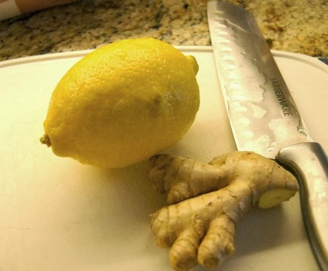 I picked up a piece of ginger that is roughly the same size as my lemon.  I then thinly slice the lemon  and ginger and put in a mason jar (any glass container will do).