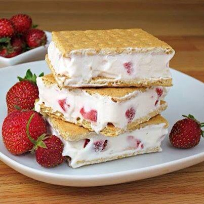 😍Strawberries and Cream Sandwiches are a chilly version of strawberries and cream.  They are similar to an ice cream sandwich except made with COOL WHIP whipped topping instead of ice cream.