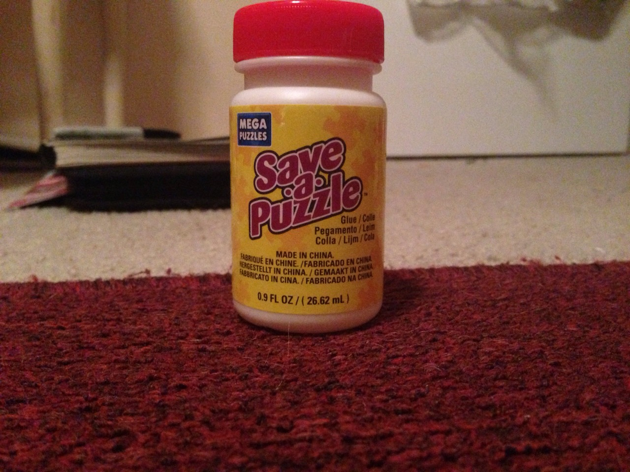 I used save a puzzle but any puzzle glue will work. Make sure it's puzzle glue not regular glue.