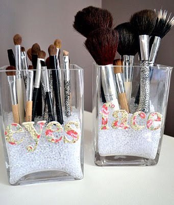 Holding Makeup in Dollar-Store Vases  Here's a cute way to organize everyday makeup implements using inexpensive dollar-store materials.