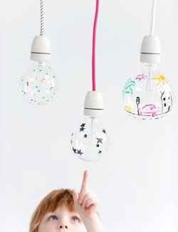 6. Use a sharpie and draw a design on a light bulb to cast a neat shadow when the light is turned on.