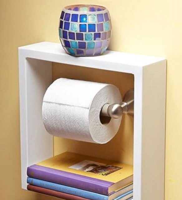 Put a square shelf around your toilet paper holder to give more shelving.